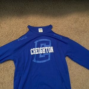 Creighton cold shoulder shirt.
